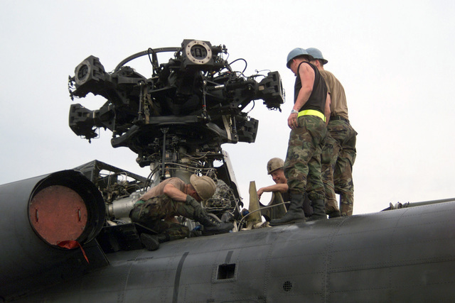 US Air Force (USAF) Airmen assigned to the 352nd Maintenance Squadron (MXS), remove the gearbox from a MH-53M Pave Low IV helicopter as they prepare the chopper for transport at Air Force Base Hoedspruit, South Africa. The 352nd is deployed at Hodespruit in support of Operation ATLAS RESPONSE. The Operation is a Humanitarian Aid Operation directed by the US European Command (USEUCOM) to help the people of Mozambique, after severe flooding displaced over a million people from their homes