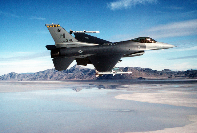 "A 419th Fighter WIng (466th Figher Squadron) ""Diamondback"" F-16C Fighting Falcon from Hill Air Base, Utah, flies a training mission over the Great Salt Lake. The 419th is one of approximately 30 flying wings in the reserve and is the only Air Force Reserve unit in Utah. If the wing were mobilized for active duty, its aircraft and most of its members would be assigned to Air Combat Command. This image was used in the April 2000 AIRMAN Magazine article""High-fivin' 'n' Huggin'."""