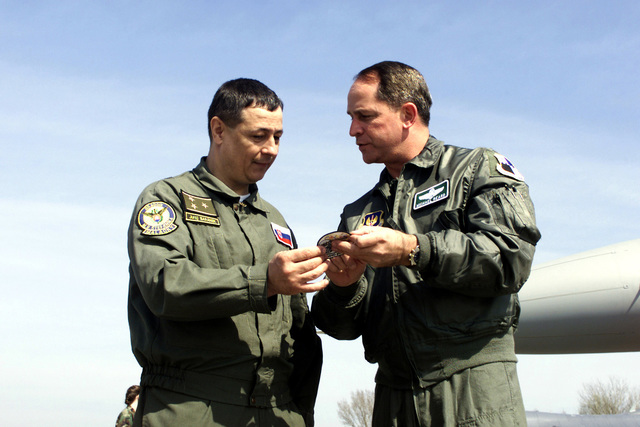 US Air Force Colonel Micheal Beard, 52nd Operations Group Commander, Spangdahlem Air Base, Germany, presents a unit patch to Slovak Air Force Colonel Juraj Baranek, the 33rd Air Base Commander at Malacky Air Base, Slovakia. More than 200 U.S. Airmen (Not shown) from Spangdahlem's 23rd Fighter Squadron are in Slovakia supporting the first American fighter training deployment to what was once part of the Soviet Union. The two-week training exercise, named Lion's Claw, is allowing U.S. pilots in Europe to expand their training