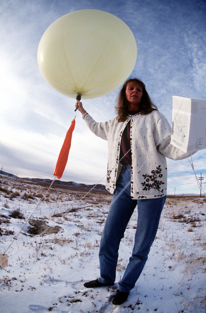 """Weather balloons provide Becky Dickson the data she needs to make a """"go or no-go"""" call on a detonation at the Utah Test and Training Range in Oasis, Utah. This image was used in the April 2000 AIRMAN Magazine article """"No Boom Becky"""""""