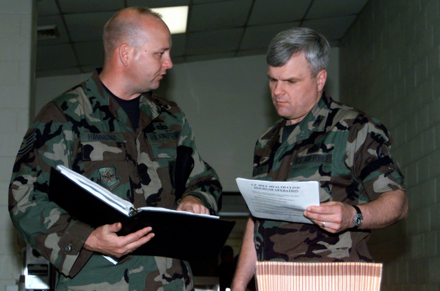 Shortly after arriving to Fort A.P. Hill, Virginia, US Air Force Technical Sergeant Pete Hammond, of the 89th Air Wing, Security Forces Squadron, briefs Deployment Commander Colonel Ron Bullock on the 89th SFS Force Protection Plan that will be used during Exercise Crisis Look 00-03