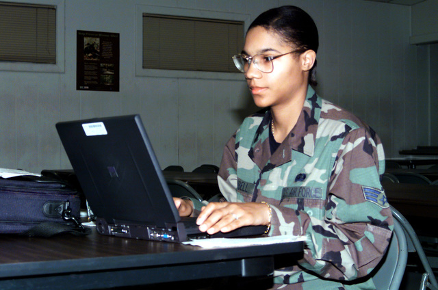 US Air Force SENIOR AIRMAN Katrina Campbell of the 89th Air Wing, Services Squadron, is refining lodging arrangements for deployed 89th Air Wing members who will be participating in Exercise Crisis Look 00-03 at Fort A.P. Hill, Virginia