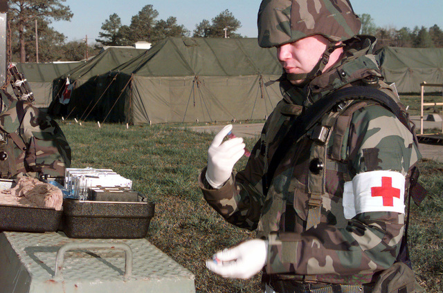 US Air Force STAFF Sergeant Christopher Amos of the 89th Medical Group, Andrews Air Force Base, Maryland, tests the drinking water for bacteria during a deployment at Fort A.P. Hill, Virginia. During the deployment, wing personnel will be evaluated on ABILITY TO SURVIVE AND OPERATE (ATSO) skill, humanitarian scenarios and base defense. (Duplicate image, see also DF-SD-01-03199 or search 000405-F-0352L-002)