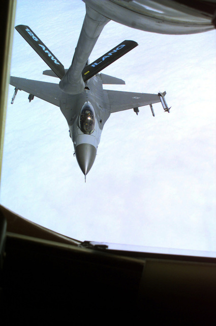 Aerial view medium shot from the boom operator's window on a KC-135 from the 126th Air Refueling Wing, Scott Air Force Base, Illinois. An F-16 Falcon from the 181st Fighter Wing, Springfield, Illinois, breaks away, after refueling in flight, from the KC-135. The refueling was observed by as part of an incentive flight, called Center of Influence, for local high school councilors, principals and vice principals to give them more information on the mission, opportunities and benefits of the Air National Guard. (Image framed as a portrait shot.)