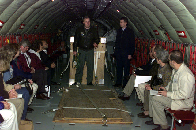 Interior medium shot from the jump seat section on a USAF KC-135 as Air Force personnel brief local high school councilors, principals and vice prinicpals during a F-16 (Not shown) refueling mission. The 126th Air Refueling Wing, Scott Air Force Base, Illinois use these rides, called Center of Influence, as a way to show the dignitaries more about the mission, opportunities and benefits of the Air National Guard