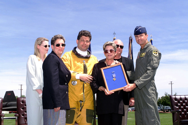 An esterior, straight on medium shot as US Air Force Brigadier General Kevin Chilton (Far right), 9th Reconnaissance Wing commander, presents Sue Powers (Holding frame), Gary Powers Jr. (In flight suit), Dee Powers Rogers (In blue blazer) the Air Force Distinguished Flying Cross at Beale AFB, California, on May 01,2000. Gary Powers Jr. and Dee Powers Rogers are son and daughter of U-2 pilot Francis Gary Powers Sr. and Sue Powers is his wife. Also representing Powers family were Gary Powers Jr. fiancee, Jen Webber (white shirt) and Dee Powers Rogers husband Mark Rogers (black suit). Francis Gary Powers Sr. was shot down while on a reconnaissance mission over the former Soviet Union on May...