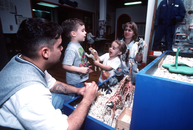 """Leonardo's Discovery Warehouse, a fun learning center for kids in Enid, Oklahoma, offers a weekend getaway for US Air Force SENIOR AIRMAN Oscar Gonzalez and his wife, Diane, and their children, Anthony, 5, and Sydney, 2. This image was used in the May 2000 AIRMAN magazine article """"Give Vance a Chance"""". The article is meant to promote a tour at Vance Air Force Base, Oklahoma, as a friendly, family raising type utopia for young Airmen. The base and local community have a very close and productive relationship"""