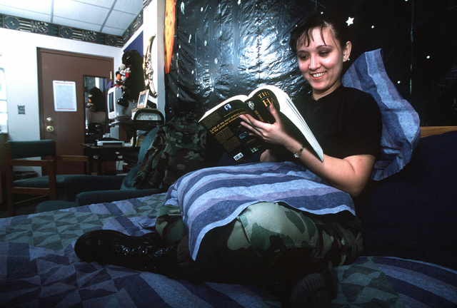 """When she wants to """"chill"""" for a while, US Air Force SENIOR AIRMAN Cathy Breingan heads for her room. She draws the curtains, turns on the black light and sits under the the stars of her homemade planetarium. """"It gives me peace,"""" she said. When her friends walk in, she said they ask, """"ooh, where's this girl from?"""" This image was used in the May 2000 AIRMAN magazine article """"Give Vance a Chance"""". The article is meant to promote a tour at Vance Air Force Base, Oklahoma, as a friendly, family raising type utopia for young Airmen. The base and local community have a very close and productive relationship"""