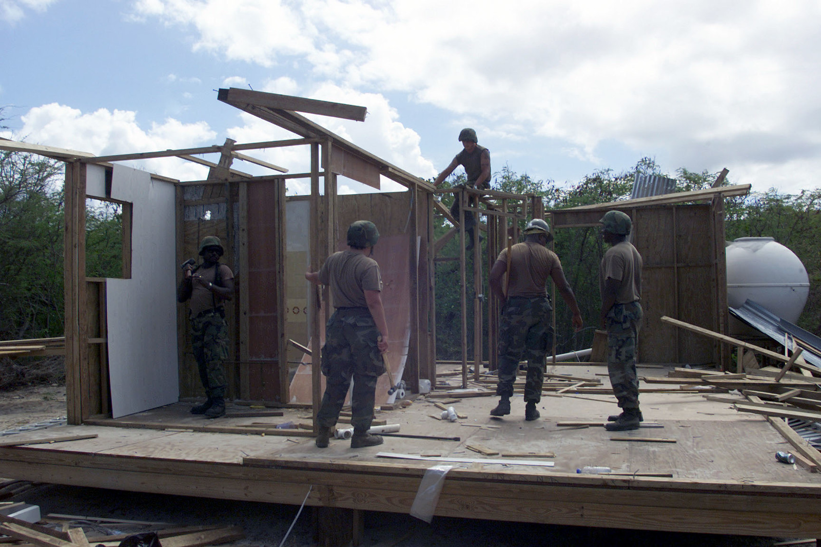 US Navy (USN) Seabees assigned to Naval Mobile Construction Battalion Five (NMCB-5) disassembles structures built by trespassers on federal property, at Camp Garcia on Vieques Island, Puerto Rico, as US Military and Department of Justice agents reclaimed the federal property on which protestors were residing for over a year