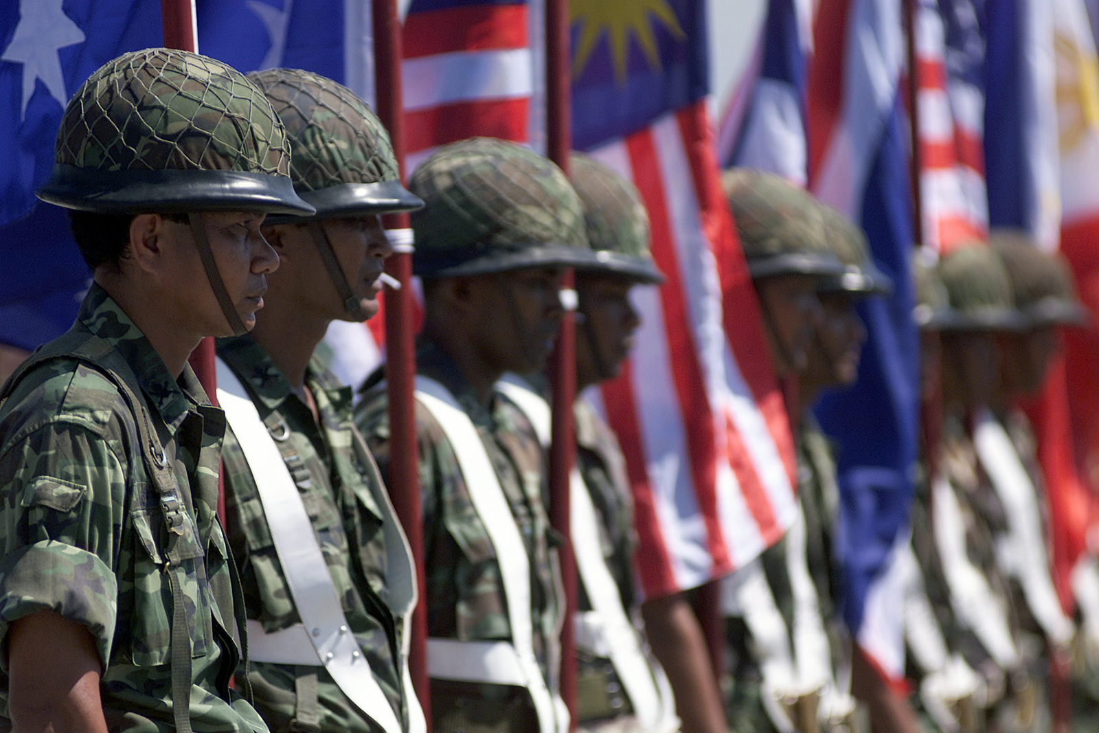 Members of the Royal Thai Army Color Guard stand at attention during the Opening Ceremony for Exercise COBRA GOLD 2000 held at Vajira Military Camp, Nakhon Si Thammarat, Thailand