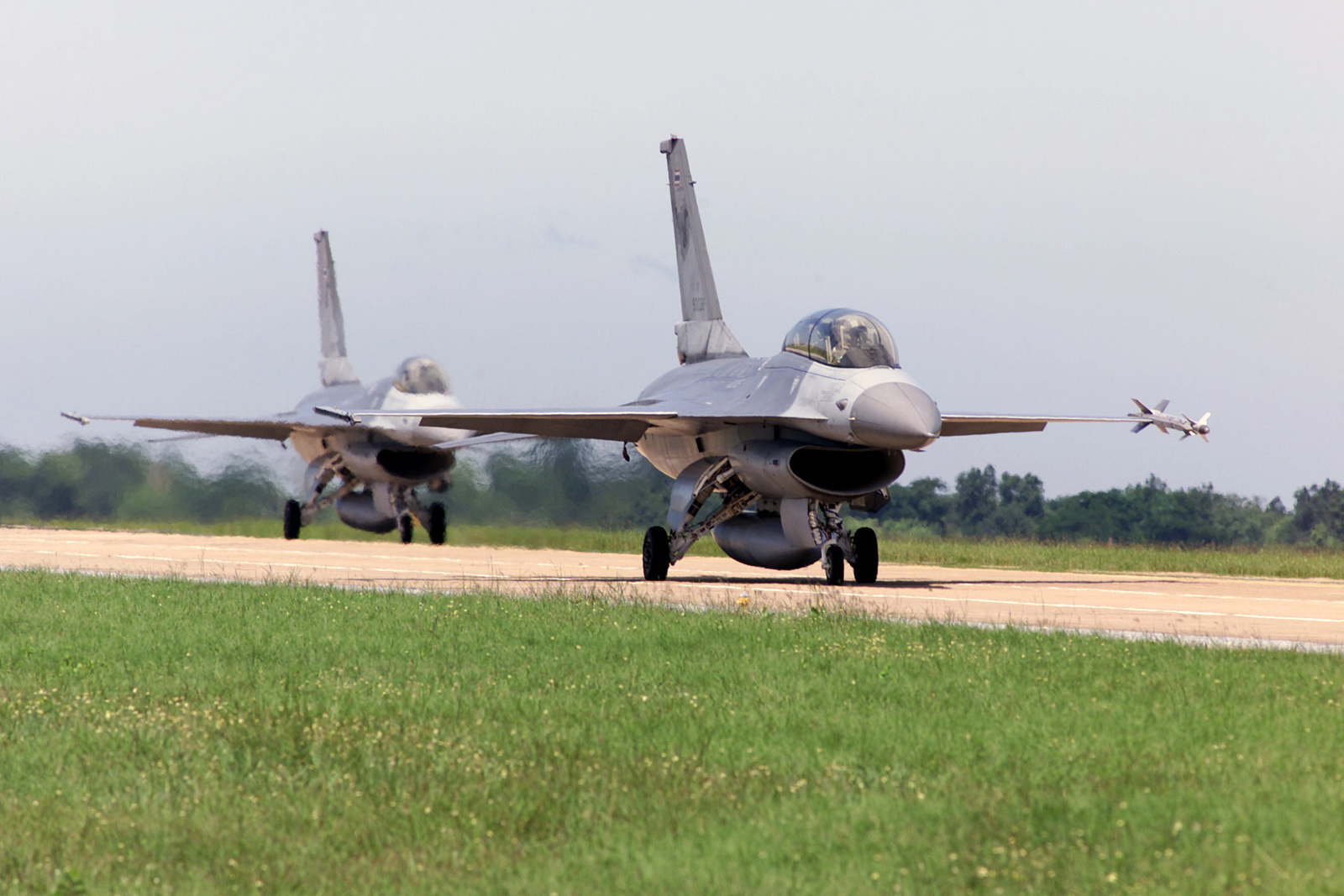 Two Royal Thai Air Force F-16 Fighting Falcon aircraft taxi