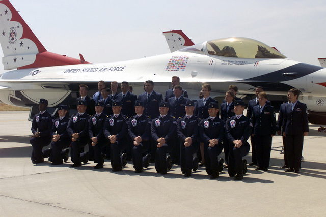 Members of the USAF Thunderbirds Aerial Demonstration Team pose for a photograph with US Air Force Reserve (USAFR) members in front of their F-16 Fighting Falcon aircraft, on the flight line at March Air Reserve Base (ARB), California (CA) during the Airfest 2000 air show
