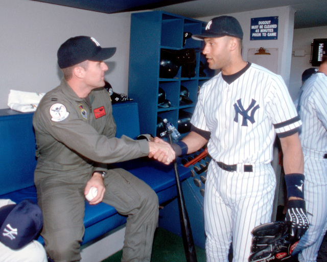 Right side front view medium close-up shot as US Air Force Special Operations helicopter pilot, Captain Bill Denehen is introduced to Yankees second baseman Derek Jeter. CPT Denehen was honored at Yankee Stadium on 11 may 2000 by throwing out the ceremonial first pitch. On May 2, 1999, while assigned with the 55th Special Operations Squadron, CPT Denehen and his crew courageously penetrated one of the most sophisticated air defense networks in the world to rescue an F-16C pilot (not shown) trapped deep inside of Serbia. This was the first mission in history where a special operations rescue force penetrated and successfully defeated an active integrated air defense system of a determined ...