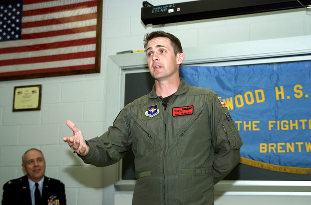 US Air Force Special Operations helicopter pilot, Captain Bill Denehen lectures to JROTC at Brentwood High School, NY on 11 May 00. On 2 May 99, while assigned with the 55th Special Operations Squadron, CPT Denehen and his crew courageously penetrated one of the most sophisticated air defense networks in the world to rescue an F-16C pilot (not shown) trapped deep inside of Serbia. This was the first mission in history where a special operations rescue force penetrated and successfully defeated an active integrated air defense system of a determined military. During Operation Allied Force, Denehen's special Ops helicopter was pre-positioned deep inside Bosnia-Herzegovina. The rescue force ...