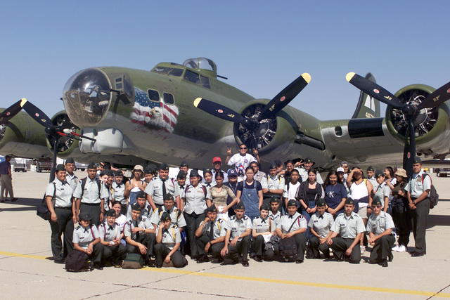 Members of the US Army Junior Reserve Officer Training Corps (ROTC) Unit from Garfield, California (CA) pose for a photograph in front of a B-17 Flying Fortress aircraft during the Airfest 2000 air show held at March Air Reserve Base (ARB), California (CA)