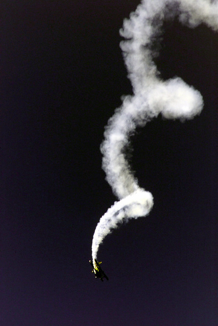 Mr. Sean Tucker performs a spiral aerobatic stunt maneuver in his Pitts 10-10-220 Challenger aircraft during the Airfest 2000 air show held at March Air Reserve Base (ARB), California (CA)