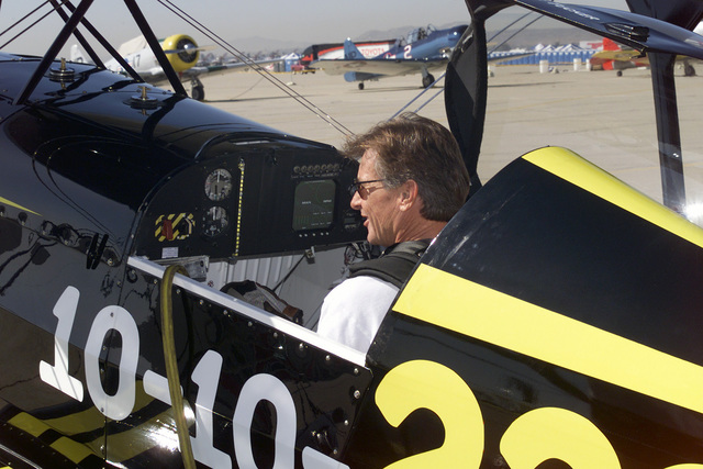 Stunt pilot, Sean Tucker perform a pre-flight check in the cockpit of his Pitts Challenger aircraft during the Airfest 2000 air show held at March Air Reserve Base (ARB), California (CA)