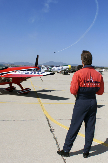 Stunt pilot, Tim Weber watches as fellow stunt pilot, Sean Tucker performs aerobatic maneuvers during the Airfest 2000 air show held at March Air Reserve Base (ARB), California (CA)