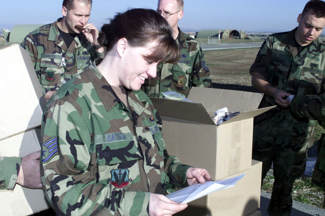 US Air Force STAFF Sergeant Penny Batista, an electrical technician for the Black Widows, 421 Fighter Squadron, Hill Air Force Base, Utah, reads a letter that was enclosed with the 2300 lbs of baked goods sent to the deployed unit from Utah. The 421st FS is deployed to Incirlik Air Base, Turkey, in support of Operation Northern Watch