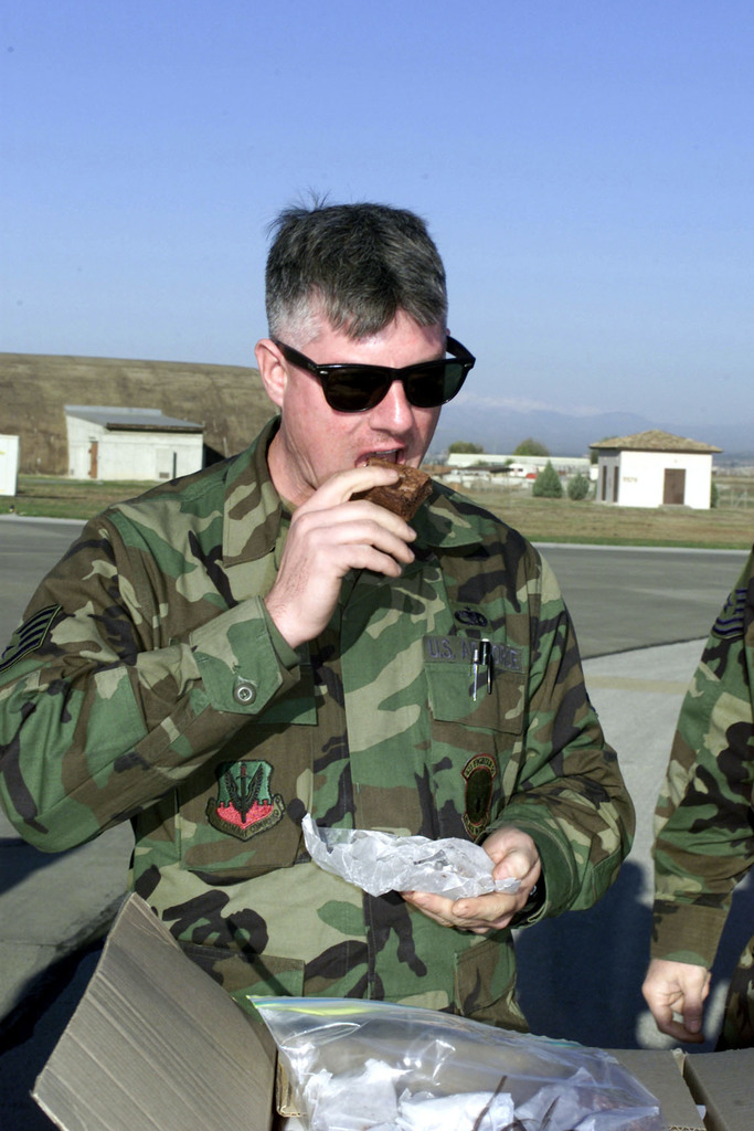 US Air Force STAFF Sergeant Richard Drake, an engine technician for the Black Widows, 421st Fighter Squadron from Hill Air Force Base, Utah, enjoys one of the 2300 lbs of baked goods sent to the deployed unit from Utah. The 421st FS is deployed to Incirlik Air Base, Turkey, in support of Operation Northern Watch