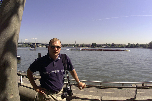 US Air Force (USAF) STAFF Sergeant (SSGT) Scott Reed, Still Photographer, 1ST Combat Camera Squadron Charleston stands near the Rhine river in the city of Mainz Germany during a tour taken by the participants of Exercise COMBINED ENDEAVOR 2000. The Exercise is a Partnership for Peace (PfP) exercise hosted by Germany and is the largest information and communications systems exercise in the world which focuses primarily on Command, Control, Communications, and Computers (C4) interoperability testing and documentation