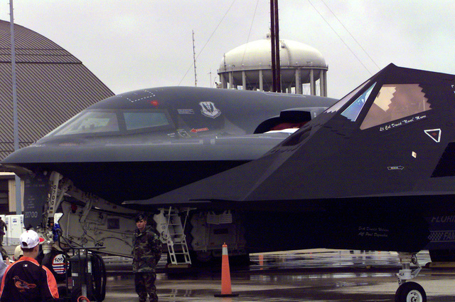 A B-2 Spirit stealth bomber and an F-117A Nighthawk attack fighter on display during the Joint Services Open House 2000