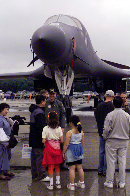 Civilians visitors view a B1-B Lancer, multi-role, long-range bomber on display during the Joint Services Open House 2000