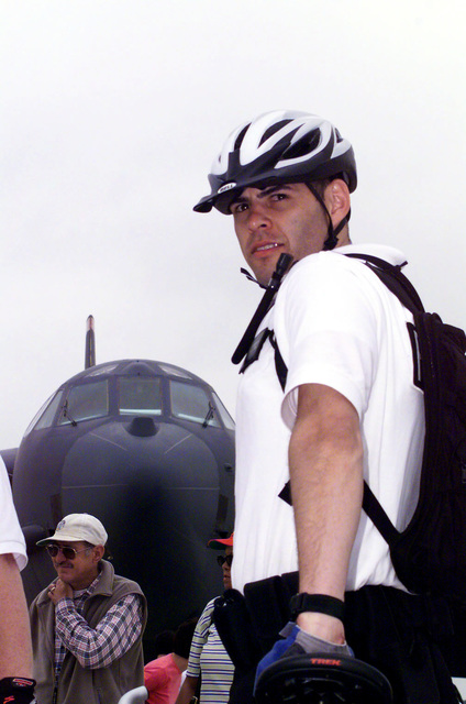 During the Joint Services Open House 2000, a member of the 11th Security Forces Squadron, Bolling Air Force Base, Washington DC, patrols the flight line display area on a bicycle