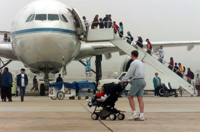 During the Joint Services Open House 2000 visitors line the boarding stairway to a lockheed L-1011 on display