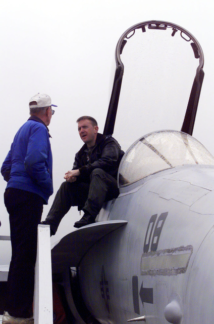 F/A-18 Hornet pilot, MAJ Phil Hein, answers questions about his fighter during the Joint Services Open House 2000