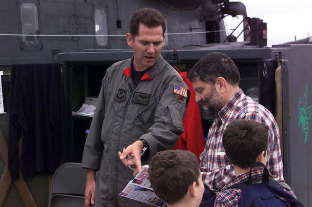LT Mike Holder of the 20th Special Operations Squadron, Hurlbert Field, Florida, answers a visitors questions about an MH-533 Pave Low Helicopter on display during the Joint Services Open House 2000