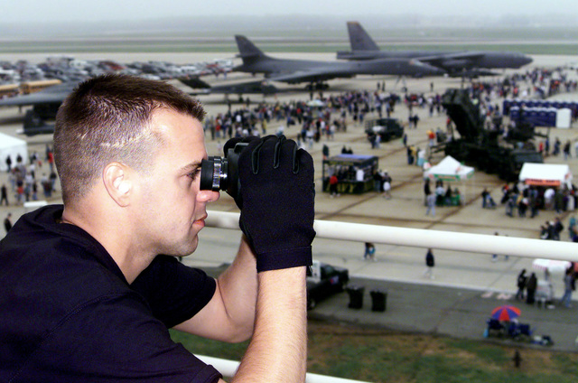SSGT Ira Brown of the 89th Security Forces Squadron keeps a close eye on the vast crowd attending the Joint Services Open House 2000