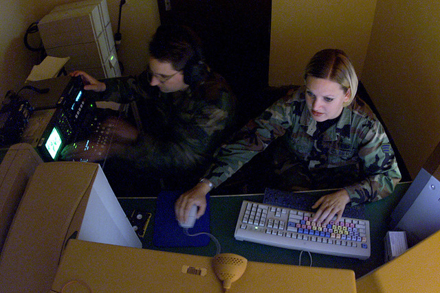 SENIOR AIRMAN (SRA) Vanessa Braly, USAF, (right), assists STAFF Sergeant (SSGT) Mike Smith, USAF, editor, review footage captured during COMBINED ENDEAVOR (CE) 2000, at Lager Aulenbach, Germany. Both are with the 1ST Combat Camera Squadron, deployed to provide video and still support for the exercise. CE 2000, currently hosted by Germany, is the largest information and communication systems exercise in the world. This exercise is the sixth in a series of multinational communication interoperability workshops where military personnel from 35 nations get together for 14 days to focus on Command, Control, Communications, and Computers (C4) interoperability testing and documentation and to...