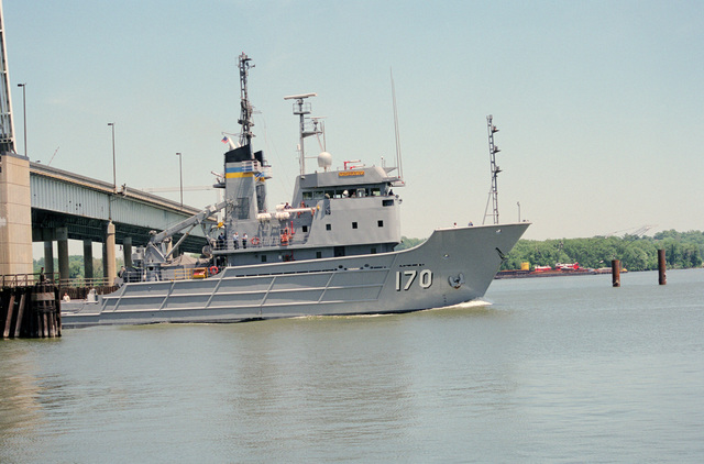 Port side bow view of the Military Sealift Command (MSC) fleet tug USNS MOHAWK (T-ATF 170) passing out of the open draw of the Woodrow Wilson Memorial Bridge en route down river