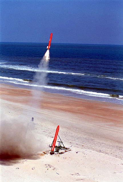 """A US Army remote-controlled """"B.A.T.S."""" target rocket lifts from its launchpad, toward an impact area on the E-1 range at Camp Lejeune's Onslow Beach area during a 2nd Low Altitude Air Defense (LAAD) Battalion missile targeting exercise. Marines from the 2nd LAAD Battalion, stationed at Marine Corps Air Station Cherry Point, North Carolina, were using the versatile rockets as fast-moving targets, firing Stinger missiles at them from the Avenger system mounted atop High-Mobility Multipurpose Wheeled Vehicles (HMMWV)"""
