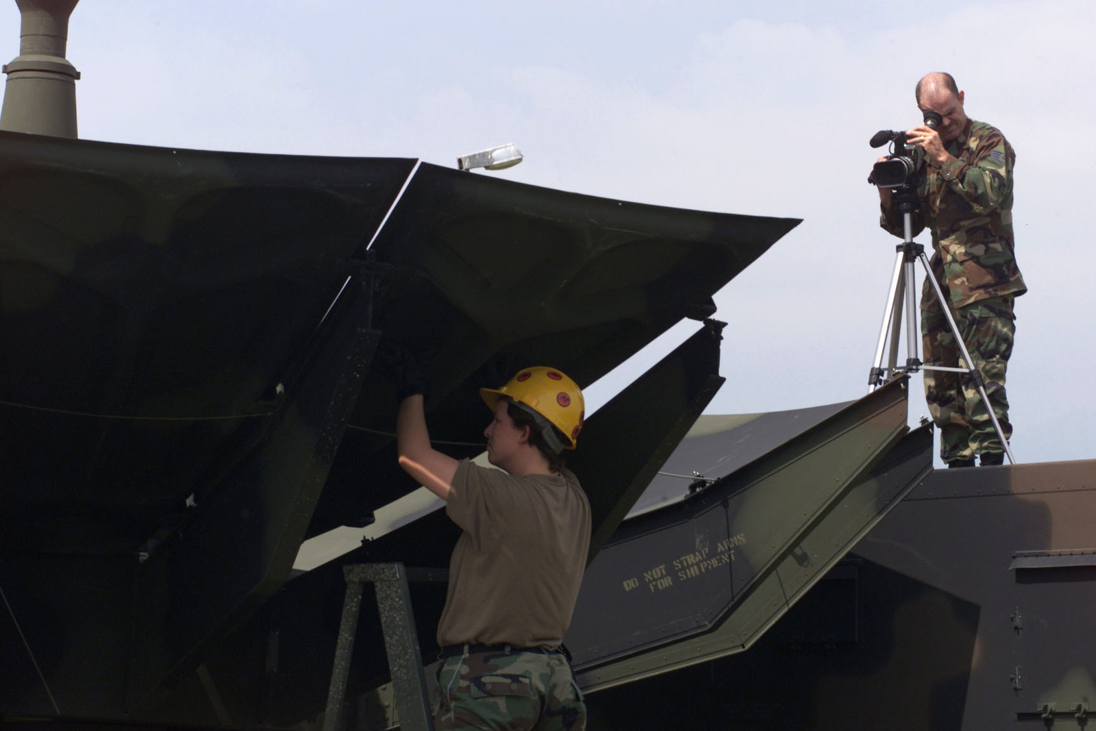 US Air Force STAFF Sergeant Ricky Anderson (Right), 31st Communications Squadron, Video Documentation Journeyman, Aviano Air Base, Italy, documents the assembly of a communications dish during VENETO RESCUE on May 31st, 2000