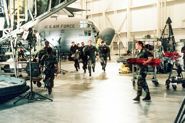"In a scene from the US Air Force-Supported film titled ""The Perfect Storm"", US Air Force pararescuemen from the 305th Rescue Squadron, Davis Monthan Air Force Base, Arizona, and the 129th Rescue Wing, Moffet Field, California, rush to their helicopter to save imperiled fisherman off the coast of New England. Primary Air Force filming happened at Channel Islands Air National Guard Base, California, and at sound stages at Warner Brothers Studios"