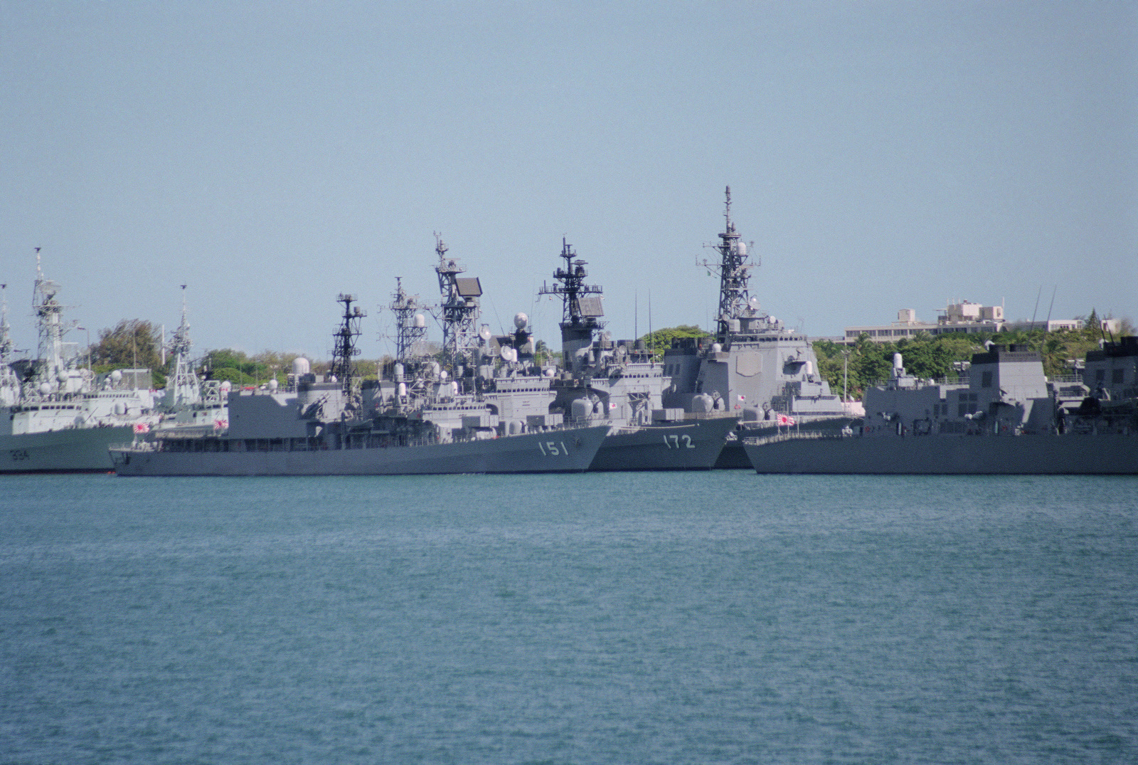 Units of the Japanese Defense Force are shown tied up at bravo pier no. 23. Visible are JDS (Japan Defense Ship) ASAGIRI (DD 151); JDS SHIMAKAZE (DDG 172) and JDS KONGO (DDG 173). Astern is the Canadian frigate HMCS (Her Majesty's Canadian Ship) REGINA (FFH 334). The ships are here to take part in Operation RIMPAC 2000
