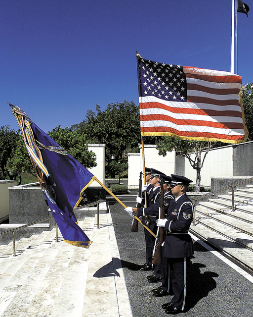 Left side profile medium shot as the Hickam Air Force Base, Hawaii, Honor Guard members from left to right, SENIOR AIRMAN Jorge Rodriguez, STAFF Sergeants Shawn knight, Angela Jimdar, and Kamaka Ahyo practice at Punchbowl National Cemetery on the fifth of June Two thousand. (Duplicate image, see also DF-SD-01-00845 or search 000605-F-5774B-001)