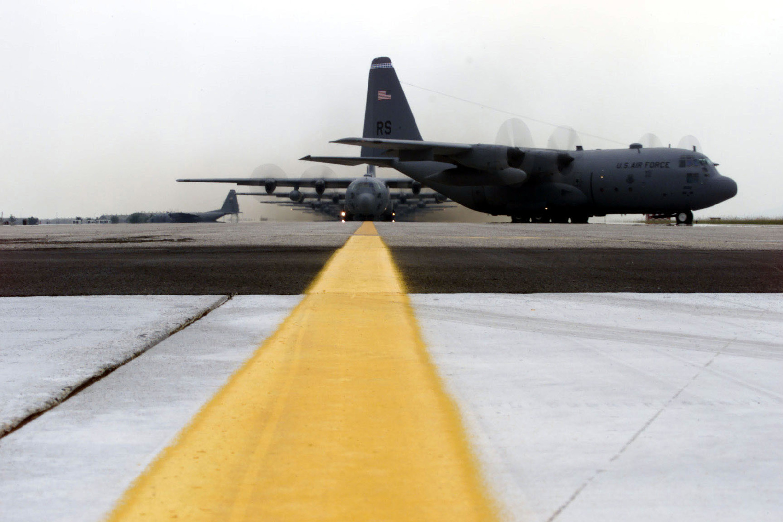 A US Air Force C-130 Hercules transport plane of the 86th Air Wing, Ramstein Air Base, Germany, starts it's turn on the runway, in preparation for take-off, in support of Exercise VENETO RESCUE. The C-130's dropped over 300 troops and multiple heavy vehicles (Troops & equipment not shown) during the drop portion of the exercise