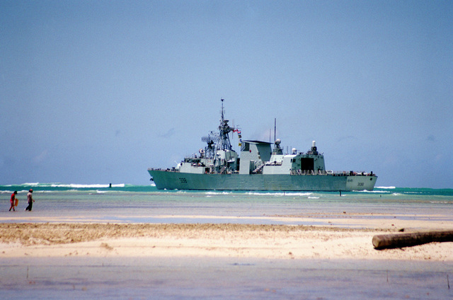 Port quarter view of the Canadian frigate HMCS WINNIPEG (FFH 338) clearing the channel at Pearl Harbor en route south to take part in Operation RIMPAC 2000