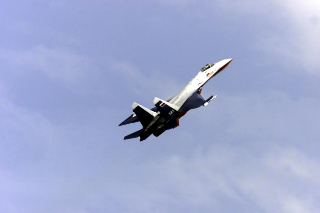 A. Kvochur, a show pilot for the Sukhoi Aircraft Manufacturer performs for the crowd in a Russian made Sukhoi Su-33 Flanker, during the LaComina Airshow held on June 11th, 2000, in Pordenone, Italy