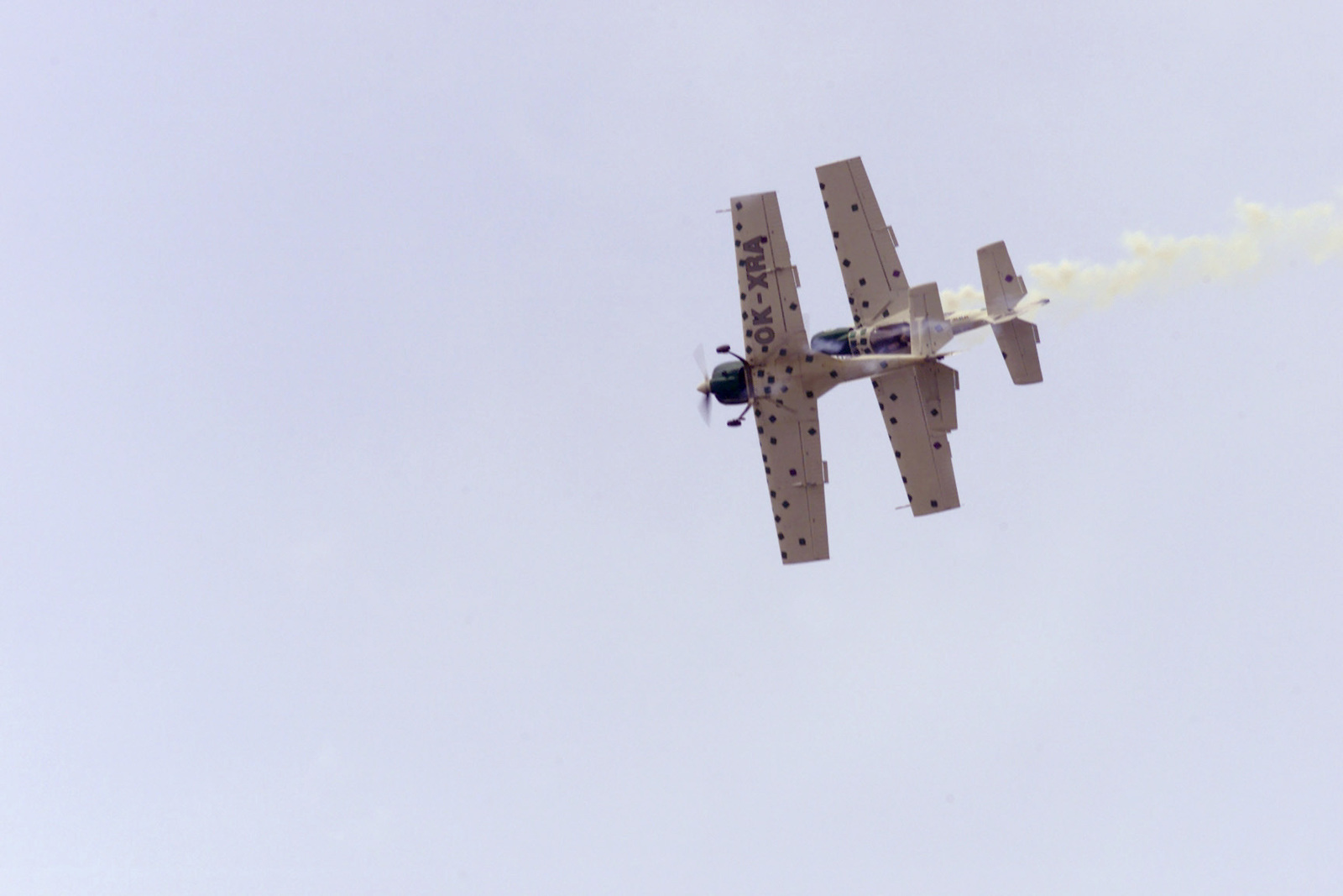 "Members of the Czech Republic Acrobatic Team, ""The Zlin Devils,"" flying Zlin 50's, perform a barrel roll with one of the team members flying inverted over the other at LaComina Aeroporto in Prdenone, on June 11th, 2000"