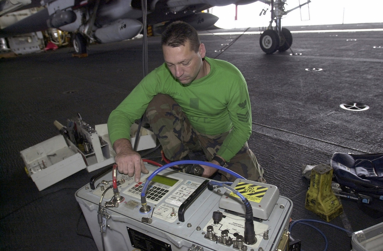 Aviation Electrician's Mate First Class PETTY Officer (PO1) Edward Harrell, USN, Fighter Squadron 31 (VF-31), Tomcatters, tests the pilot system and static system on the F-14 Tomcat in support of Rim of the Pacific 2000 (RIMPAC 2000), a major maritime exercise, in the vicinity of Hawaii. RIMPAC 2000 is designed to enhance the tactical capabilities of participating units in major aspects of maritime operations at sea