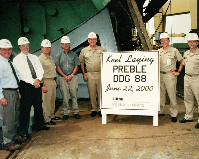 Keel laying of the Arleigh Burke Block IIA Aegis class guided missile destroyer USS PREBLE (DDG 88). Left to right: Paul Robinson, Vice President, Operation; Bob Merchent, Program Manager, Aegis Programs: Captain Fred Parker, PEO/TSC Associate Program Manager: Jerald Read, General Ship Superintendent; Rear Admiral (Upper half) William W. Cobb Jr., PEO/TSC Program Executive Officer, Captain Harry Rucker, Supervisor of Ship-building; Commander Steve Metz, Aegis Area Commander