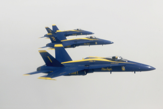 Right side profile, medium aerial shot, of three F/A-18 Hornets from the US Navy's Blue Angel Aerial Demonstration Squadron. The team was flying over the skies of McGuire Air Force Base, New Jersey. The mission of the Blue Angels is to enhance Navy recruiting, and credibly represent Navy and Marine Corps aviation to the United States and its Armed Forces to America and other countries as international ambassadors of good will. An estimated 15 million spectators view the squadron during air shows each year. Additionally, the Blue Angels visit over 50,000 people a show season (March through November) at school and hospital visits. The Blue Angels were headed to the National Guard in Rhode...