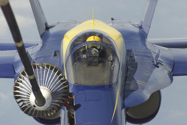 Straight on medium aerial close-up of the refueling a US Navy F/A-18 from the Blue Angels' Aerial Demonstration team. Just the refueling hose and nozzlechute is seen from the USAF KC-10 Extender that is refueling the F/A-18. The Blue Angels are flying over McGuire Air Force Base, New Jersey, on June 22nd, 2000. The mission of the Blue Angels is to enhance Navy recruiting, and credibly represent Navy and Marine Corps aviation to the United States and its Armed Forces to America and other countries as international ambassadors of good will. An estimated 15 million spectators view the squadron during air shows each year. Additionally, the Blue Angels visit over 50,000 people a show season ...