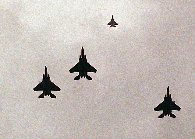 USAF F-15C'S from the 493rd Fighter Squadron, 48th Fighter Wing, Royal Air Force Base Lakenheath, United Kingdom, fly directly overhead the camera position and perform the missing man formation during the Battle of Britain ceremony at the Battle of Britain Memorial Park, Royal Air Force Base Lakenheath. This is the 29th annual and final gathering of pilots who took part in the aerial battle