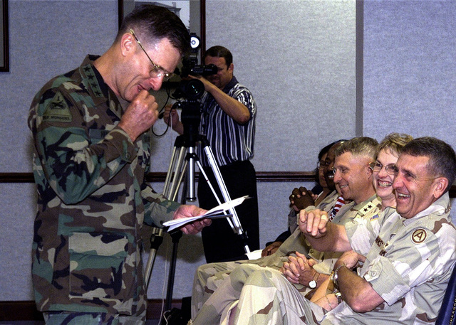 Phil Manson, Videographer, captures a humorous moment between US Army General John W. Hendrix (left), Commander, Forces Command, and (left from foreground to background) USA Lieutenant General Tommy R. Franks, Commander, Third Army, and his wife, USA Major General Edwards, Deputy Commanding General, Third Army, USA Command Sergeant Major Robert Brown, Command Sergeant Major Third Army and his wife, during an awards ceremony at the Third Army Headquarters at Fort McPherson, Georgia