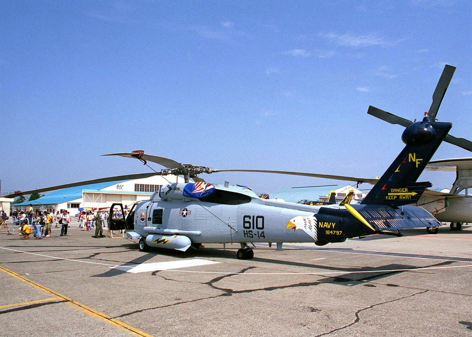 """Naval Air Facility (NAF), Atsugi, Japan, hosts the """"Wings 2000"""" Air show, featuring various static displays such as this SH-60 """"Sea Hawk'' assigned to the """"Chargers"""" attached to Helo Anti-Submarine Squadron One Four (HS-14)"""